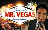 """Mr. Vegas (King Eddy) führt Sie als """"Voice of Vegas"""" durch einen geschmackvollen Event! Erleben Sie unvergessene Evergreens wie """"New York – New York"""" und """"Viva Las Vegas. King Eddy ehrt in dieser Show seine musikalischen Helden! Professioneller Vegas Gesang für Events aller Art. Die Show kann am Stück z.B. 30, 60, 90, 120 Minuten oder in mehreren Teilen á. 20-30 Minuten gespielt werden. Erleben Sie mit Ihren Freunden, Kunden, Mitarbeitern oder Ihrer Familie – Entertainment pur… Die großen Hits von: Rat Pack Tom Jones Dean Martin Bobby Darin Elvis Presley Tony Christie Neil Diamond Frank Sinatra Michael Buble Barry Manilow Wayne Newton The Blues Brothers Engelbert Humperdinck uvm."""